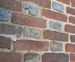 Flemish bond wall, notice the enamel-covered smaller bricks
