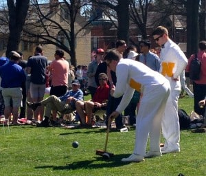 Hunter hits ball at 2014 Annapolis Cup croquet match