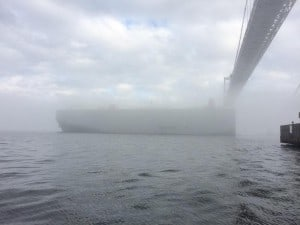 Cargo ship under foggy Chesapeake Bay Bridge