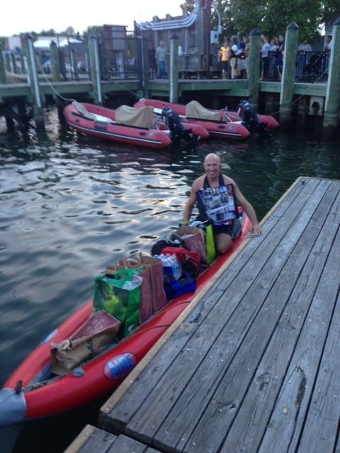 "Ren ""Ubered"" back to Annapolis' City Dock, where he'd left the inflatable kayak, and piled his in groceries carefully inside for the paddle back to the boat, which was on a mooring ball in the Annapolis harbor. He's still wearing his bag-shirt. Graul's provided him with new grocery bags."