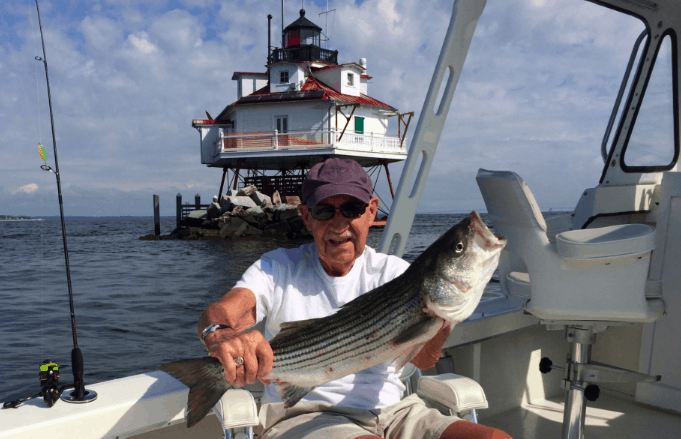 Albert Oster catches a rockfish