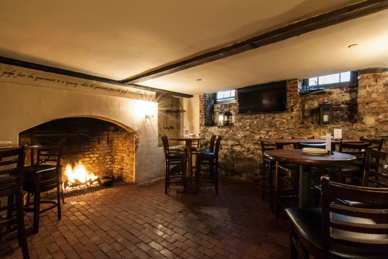 1747 Pub in the basement of Reynolds Tavern. This is the former kitchen of the historic colonial home. Live music is tucked into the corner on weekends. (photo courtesy Reynolds Tavern)