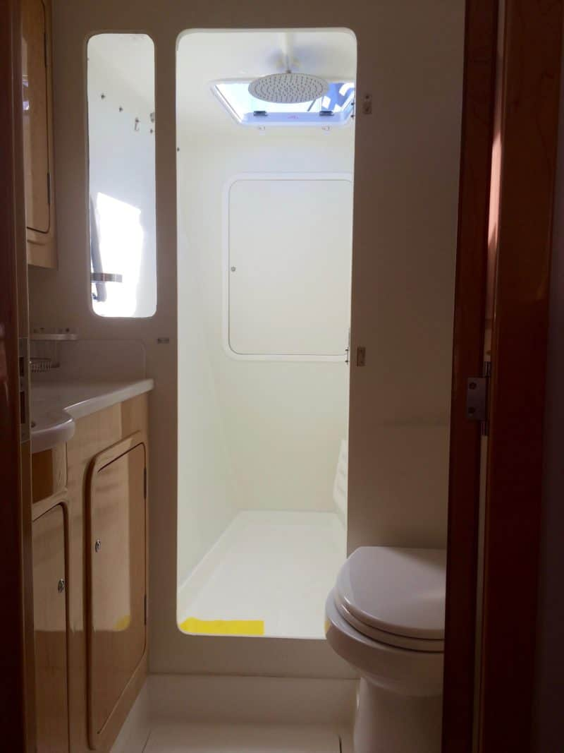 The master cabin's 'head'. it's unusually large with a full-sized shower and separate sink and toilet.