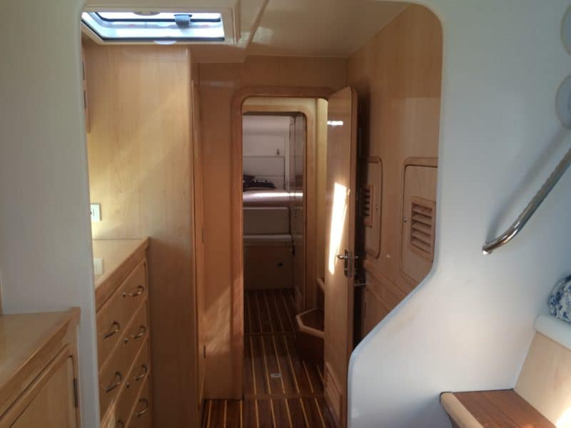 The view down the hall to the other, slightly smaller cabin with it's own bathroom at the end.