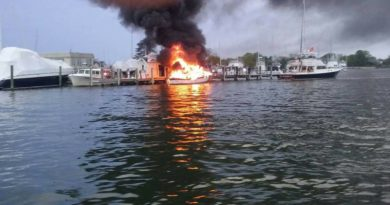 Charter boat captain risks explosion to tow burning boat away from fuel pump