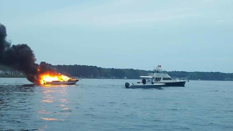 Burning boat being towed from Solomons Island marina