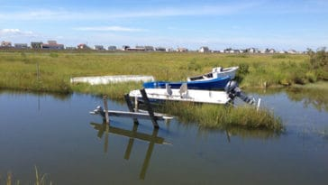 Boats laying on their side in the Tangier Island tidal marsh