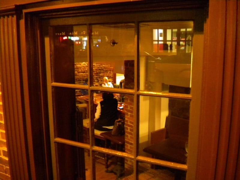 Window into Drummer's Lot Pub in the basement of historic Maryland Inn in Annapolis